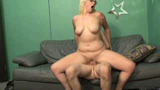 Chubby blonde milf with glasses takes a cumshot on her fat pussy
