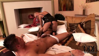 Punk bitch in fishnet stockings dominates a man with her feet