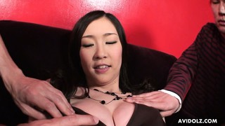 Asian brunette has many hands on her body and then gets naked
