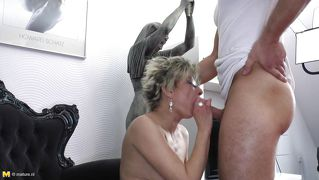 Spectacles mature bitch drilled from behind by a young dick