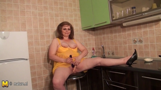 Chubby Housewife In The Kitchen