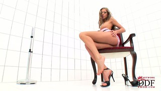 Attractive blonde with pretty tits and hot legs britney jumps on top of a big dildo