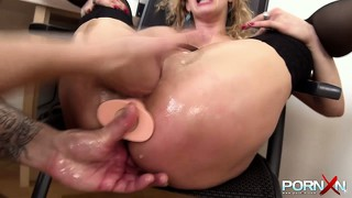 His secretary plugs her ass with his huge dildo, and fists her pussy