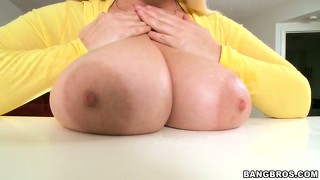 This fat blonde loves to tease with her amazingly massive boobs