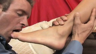 Audrey sensually drops her black pantyhose and sends her feet caressing his body