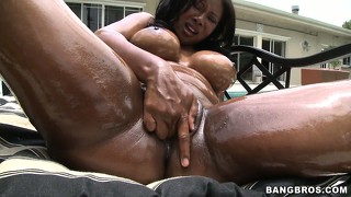 Dazzling ebony lady with huge tits brings her desires to fruition by the pool