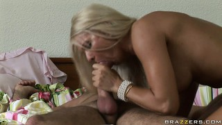 This busty blonde slut sucks him off while he teases her nipples
