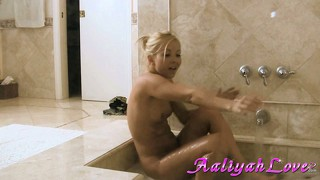 Gorgeous slender blonde with small tits and a perfect ass gets ready for a bath