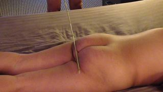 Slut Gets Caned Again
